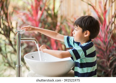 Boy washing hand