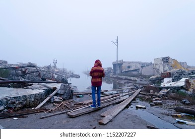 boy watching the flood in Epecuen, Buenos Aires, Argentina. Climate change.