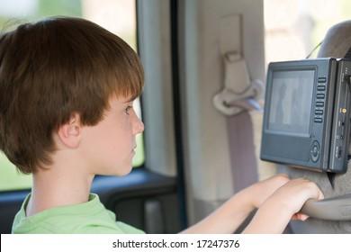 Boy Watching Movie in Van