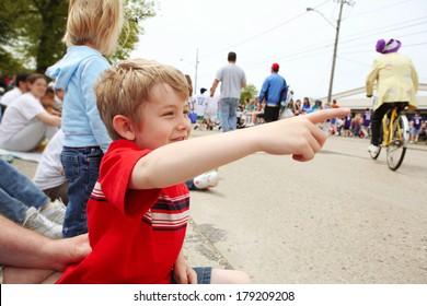 Boy watching a parade,