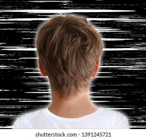 Boy watching white noise interference on tv screen