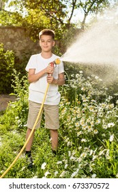 Boy watering flowers