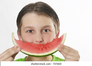 Boy with a watermelon making a smiley face.