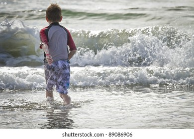 Boy In The Waves