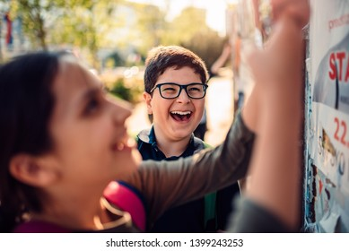 Boy wearing eyeglasses hang out with his friends and laughing