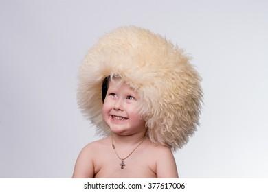 Boy wearing funny furry winter hat