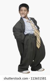 Boy wearing oversized suit and bending backward