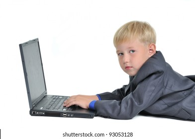 Boy wearing suit working on laptop, isolated on white background
