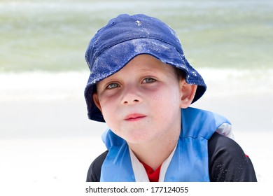 Boy wearing a sun hat to protect from UV rays