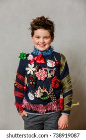 a boy wearing an ugly homemade christmas sweater
