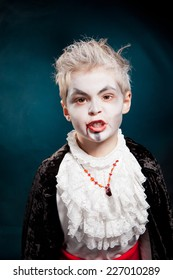 boy wearing as vampire for halloween
