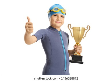 Boy wearing a wetsuit and a swimming cap and googles and holding a golden trophy showing thumbs up isolated on white background