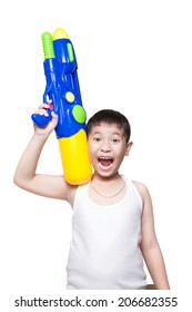 A boy wearing a white vest, His holding a water gun on shoulder and happy playing (for songkran day). isolate on white background