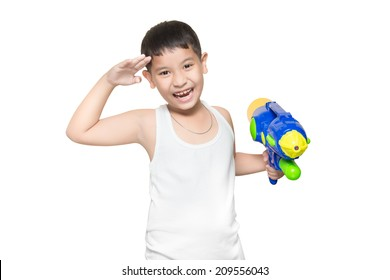 boy wearing a white vest, His holding a water gun and stand at salute very happy playing (for Songkran day). isolate on white background.