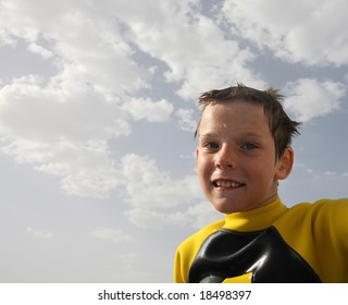Boy with wet hair against the background of the sky after snorkeling.