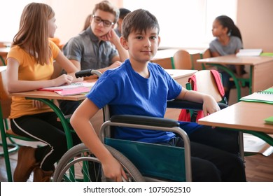 Boy in wheelchair in classroom at school