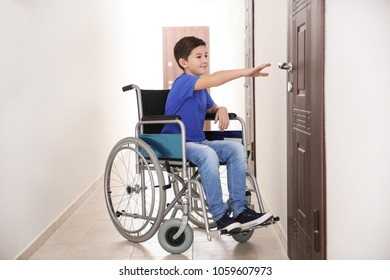 Boy in wheelchair at school corridor