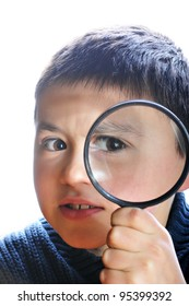 The boy which examines in a magnifier