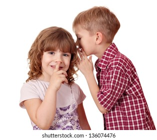 boy whispering a secret little girl