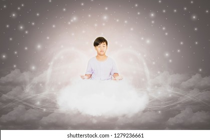 Boy in white clothes, sitting in meditation with pure spirit,on calm clouds floating,background is sky and cloud,concept of discovering truth of life to develop mind