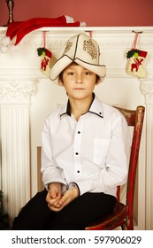 Boy in white shirt and kyrgizian hat