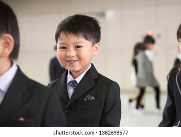 The boy who enters at the entrance ceremony of the elementary school
