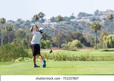 A boy who plays golf