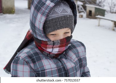 boy in winter in scarf,Portrait of a boy in the winter neck is tied with a scarf