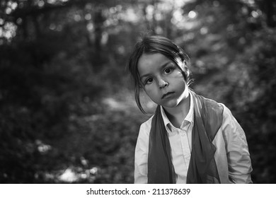 boy in the woods black and white photography