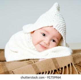 boy in a woolen cap on a warm plaid