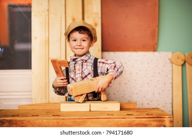 The Boy working in a carpentry workshop.