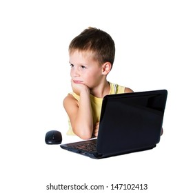 Boy working on a laptop on white background