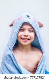 Boy wrapped in towel after bath