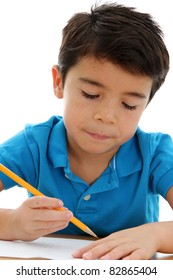 Boy writing on paper at his school