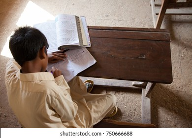 Boy writing and Studying. Thatta, Sindh, Pakistan - September 08 2015. Government Schools Condition.