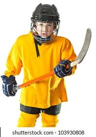 Boy in yellow hockey uniform rise up his stick