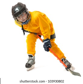 Boy in yellow hockey uniform with stick in crouch position