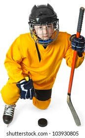 Boy in yellow hockey uniform with stick stand in knight position