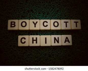 Boycott China, word cube with background.