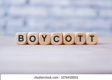 BOYCOTT word written on wood block