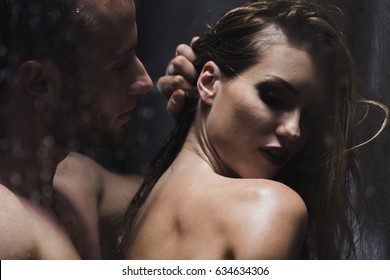 Boyfriend caressing his sexy girlfriend back during sensual foreplay