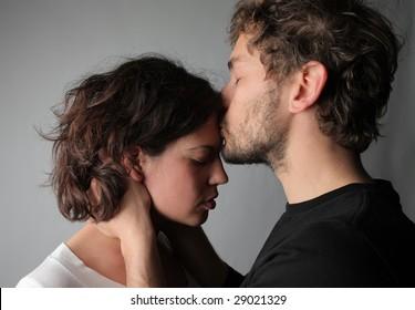 boyfriend comforts young female