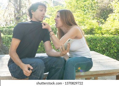 boyfriend couple discussing why the woman discovers infidelity messages on his mobile phone. couple infidelity concept