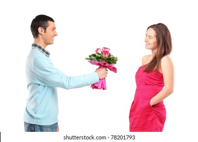 Boyfriend giving bunch of flowers to his girlfriend isolated on white background