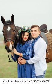The boyfriend hugs a dreamed girlfriend who holds a horse for a bridle