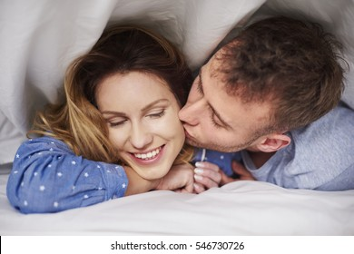 Boyfriend kissing girl on the cheek