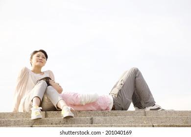 The boyfriend resting on girlfriend's lap