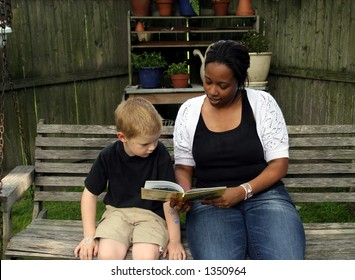 A boys babysitter reading him a story.