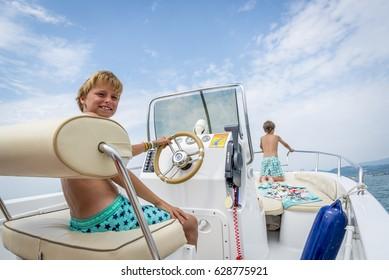 boys in a boat at lake garda, italy