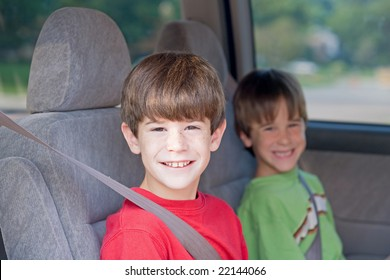 Boys Buckled up in Automobile